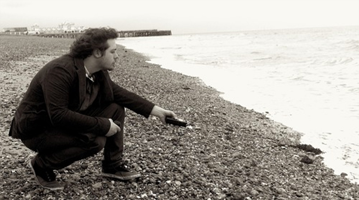 Tom Cleghorn on the beach, recording the sound of the sea