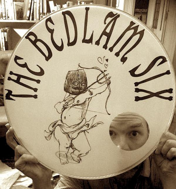 Louis peeks through The Bedlam Six bass drum skin