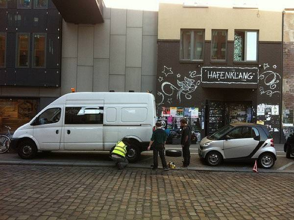 Biff (in hi-vis jacket) repairs the Bedlam Six van