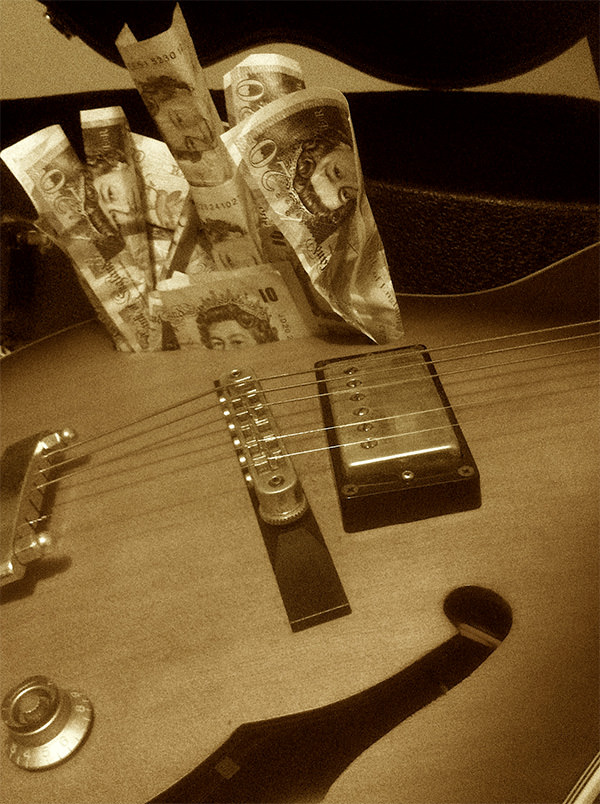 Guitar with banknotes in the background