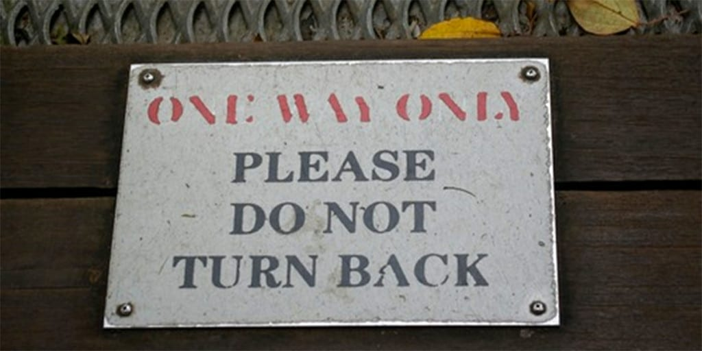 Old sign reading One Way Only: Please Do Not Turn Back